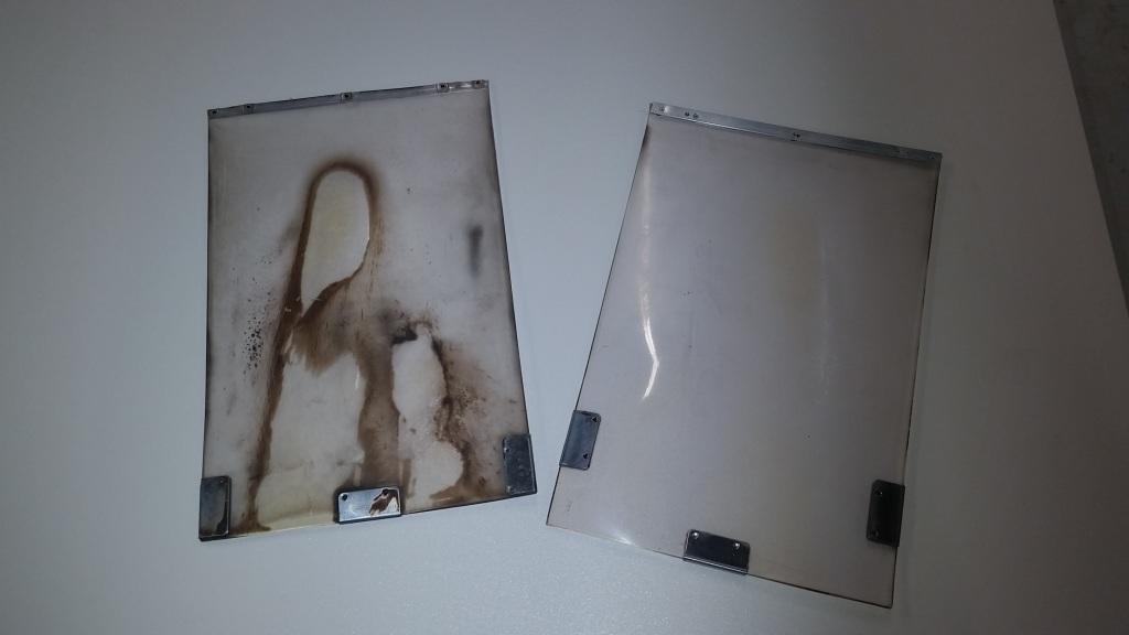 Dirty pet door flap compared with a clean Hale Pet Door flap